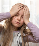 Girl suffering from headache Stock Photo