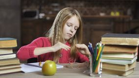 Girl suffering from headache while doing homework stock video