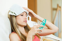 Girl suffering from headache  taking a pills Royalty Free Stock Images