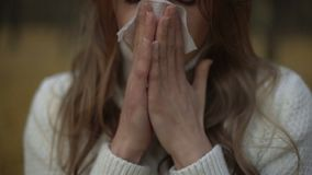 Girl suffering from runny nose and teardrop discharge, symptom of seasonal virus. Stock footage stock video footage