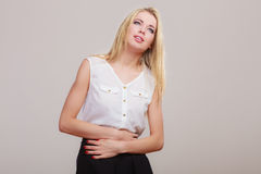 Girl suffering from stomach pain Stock Photo