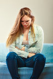 Girl suffering from stomach pain Royalty Free Stock Photos