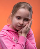 Girl suffering from a toothache Stock Image