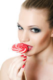 The girl with a sugar candy Stock Photo