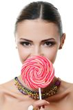 The girl with sugar candy Royalty Free Stock Image
