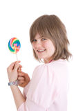 The girl with a sugar candy isolated on a white Stock Photos