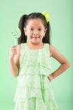 Girl with sugarplum Stock Image