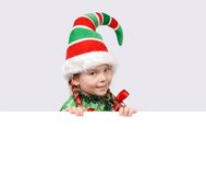 Girl in suit of Christmas elf with the banner Royalty Free Stock Photo