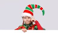 Girl in suit of Christmas elf with the banner Stock Photo