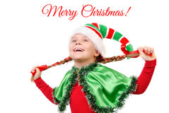 Girl in suit of Christmas elf over white Royalty Free Stock Photography
