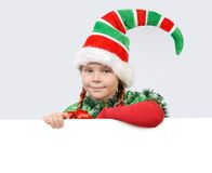 Girl in suit of Christmas elf with white banner Royalty Free Stock Photography