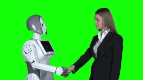 Girl welcomes the robot takes his hand and says hello. Green screen. Slow motion. Girl in a suit greets the robot, takes his hand and says hello. Green screen