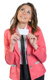 Girl in suit holding blank business card isolated Stock Photography
