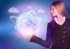 The girl in suit holding a planet aircraft flying Stock Images
