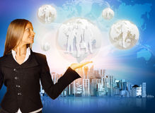 The girl in a suit holding planet with silhouettes Royalty Free Stock Photo