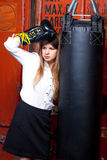 Girl in a suit near punch bag Stock Photos