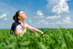 Girl in suit resting in field Royalty Free Stock Photo