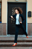 Girl in a suit running hurry. Royalty Free Stock Images