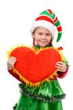 Girl in suit Santa's elf holds heart . Isolated on the white background Royalty Free Stock Image