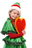 Girl in suit Santa's elf holds heart. Girl in suit Santa's elf holds heart . Isolated on the white background Royalty Free Stock Photography