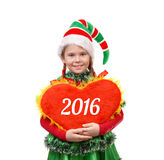 Girl in suit Santa's elf holds heart Stock Images