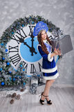 Girl in suit Snow Maiden with gift. Christmas. Royalty Free Stock Images