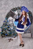 Girl in suit Snow Maiden with gift. Christmas. Royalty Free Stock Photo
