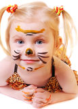 Girl in suit of tiger Stock Images