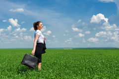 Girl in suit walking on field Stock Photography