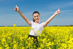 Girl in suit at yellow flower field show best gesture Royalty Free Stock Image