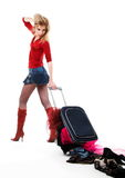 The girl with a suitcase. The girl looks at scattered things from a suitcase Stock Photo