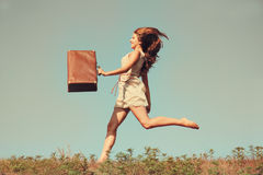 Girl  with a suitcase. Royalty Free Stock Photography