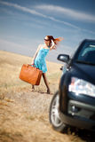 Girl and suitcase. Laughing girl with the suitcase near the car Stock Photo