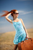Girl and suitcase Royalty Free Stock Photo