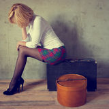 Girl with a suitcase and box Royalty Free Stock Photos