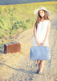 Girl with suitcase Stock Photos