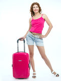 Girl with a suitcase going traveling Stock Image