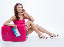 Girl with a suitcase going traveling Stock Photos