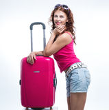 Girl with a suitcase going traveling Stock Photo