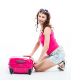 Girl with a suitcase going traveling Royalty Free Stock Photos