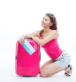Girl with a suitcase going traveling Royalty Free Stock Image