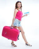 Girl with a suitcase going traveling Stock Photography