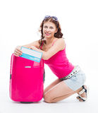 Girl with a suitcase going traveling Royalty Free Stock Photo