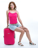 Girl with a suitcase going traveling Royalty Free Stock Photography