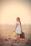 Girl with suitcase and hat Royalty Free Stock Image