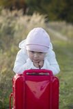 Girl with a suitcase Stock Images