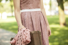 Girl with suitcase. In nature Royalty Free Stock Photos
