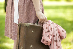 Girl with suitcase. In nature Stock Photo