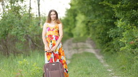 Girl with a suitcase stock footage