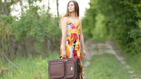 Girl with a suitcase stock video